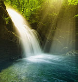 Waterfall illuminated by sunshine — Stock Photo