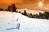 закат над снежный пейзаж — Стоковое фото