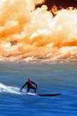 Surf at sunset — Stock Photo