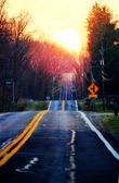 Sunset on the road — Stock Photo