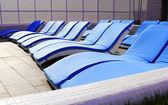 Relax by the pool on a sun lounger — Fotografia Stock