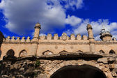 Old castle on blue sky background — Stok fotoğraf