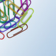 Colorful paper clips scattered in a chaotic manner. — Stock Photo #51182291