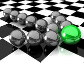 3d Grey arrow of the balls with the green leader in front — Stock Photo