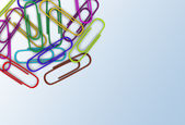 Colorful paper clips scattered in a chaotic manner. — Stok fotoğraf