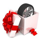 Wheel a present opened gift box — Foto de Stock