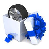 Wheel a present opened gift box — Stock Photo