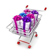Shopping cart with gifts — Stock Photo