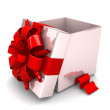 Opened gift box, with a red ribbon like a present — Stock Photo #51277069