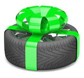 Gift wheel, tied with a green ribbon — Stock Photo