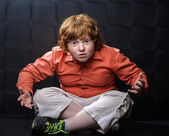 Freckled red-hair boy posing on dark background. — Stock Photo