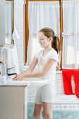 Teenage girl washing her hands — Stock Photo