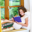 Cute teenage girl siiting on window siil — Stock Photo #48948755