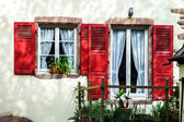 Renovated windows in village house — Stock Photo