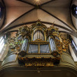 Beautiful old organ decorated by gold — Stock Photo #48993889