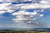 Big cumulus clouds over the land — Stock Photo