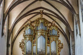 Beautiful old organ decorated by gold — Stock Photo