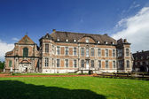 Old abbey in small belgium city — ストック写真