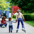 Young girl skating with little syster — Stock Photo #49016767