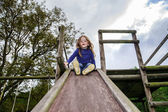 Young girl and wooden teeter board — Stock Photo