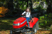 Easy driving of agrimotor by young girl — Stock Photo