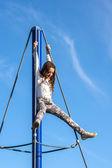 Teenage girl playing on playground — Stock Photo