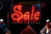 Red neon word Sale in shop window — Stock Photo