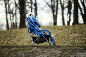 Baby stroller in spring park — Stock Photo