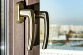Gold window handles — Stock Photo