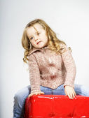 Cute little girl posing in studio — Stock Photo