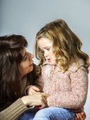 Mother reassuring little daughter — Stock Photo
