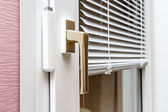 Aluminium blinds on PVC window — Stock Photo
