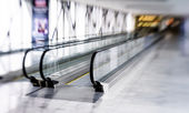 Tilt-shift view of horizontal escalator — Stock Photo