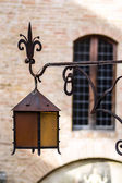 Old-style street lamp in medieval city — Stock Photo