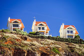 Apartments on rocks — Stock Photo
