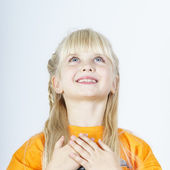 Cute little towhead girl waiting for miracle — Stock Photo
