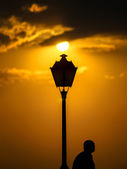 Street lamp and man silhouette — Stock Photo
