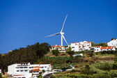 Wind energy turbine power station over the village — Stock Photo
