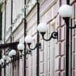 Street lamp line on house — Stock Photo #49571681