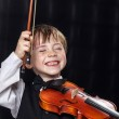 Freckled red-hair boy playing violin. — Stock Photo #49573977