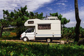 Touristic caravan in a forest — Stock Photo