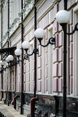 Street lamp line on house — Stock Photo