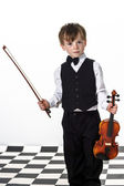 Freckled red-hair boy playing violin. — Stock Photo