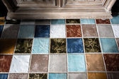 Colorful tile plunch on the floor — Stock Photo