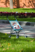 Single baby carriage in the park — Stock Photo