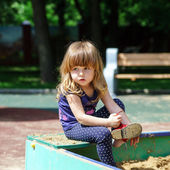 Cute little girl playing on playground — Stock Photo