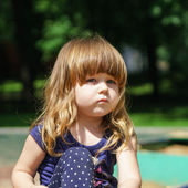 Cute little girl playing on playground — Foto de Stock