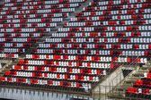 Giant tribune with colorized seats — Stock Photo