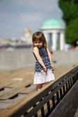 Cute little girl in the street — Stock Photo