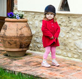 Cute little girl in a country — Stock Photo